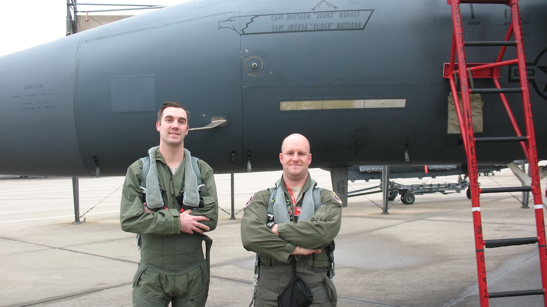 Tech. Sgt. Chris Bieber, 26th Operational Weather Squadron (OWS) shift supervisor, and Capt. Matthew Mooney, a 333rd Fighter Squadron F-15E pilot, stand in front of an F-15E Strike Eagle aircraft at Seymour Johnson Air Force Base, North Carolina, Feb. 21, 2019. Bieber was one of two 26th OWS Airmen to receive a familiarization flight aboard two F-15E Strike Eagles to see firsthand how their weather products affect the fighters' mission. (Courtesy photo)