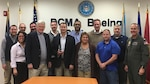 A group of DCMA team members stand together after receiving award.