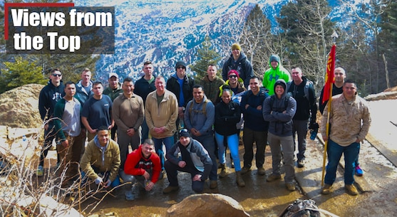 U.S. Marine Corps top performing staff non-commissioned officers and recruiters from the 8th Marine Corps District pose for a photo during a hike up the Manitou Incline in Manitou Springs, Colorado.