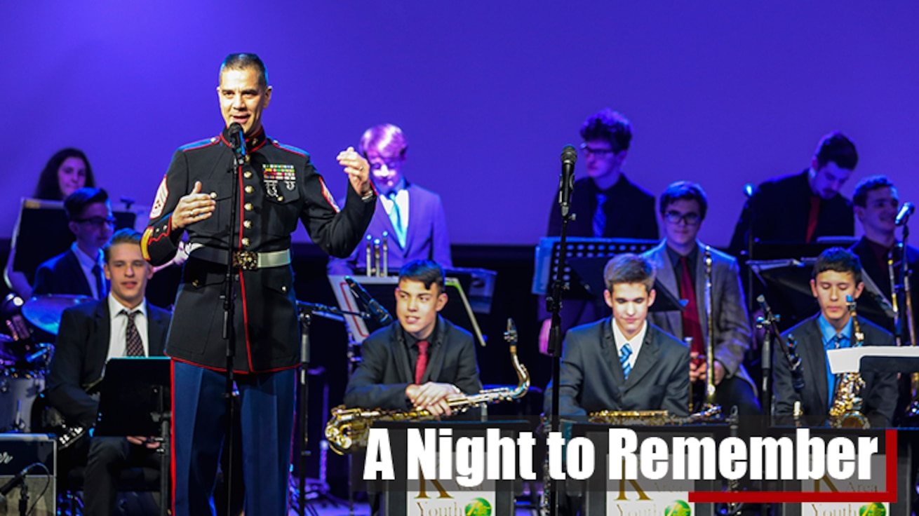 U.S. Marine Corps Gunnery Sgt. Ken Ebo, a musical technical assistant for the 8th Marine Corps district performs alongside a high school musician from the Keller school district.