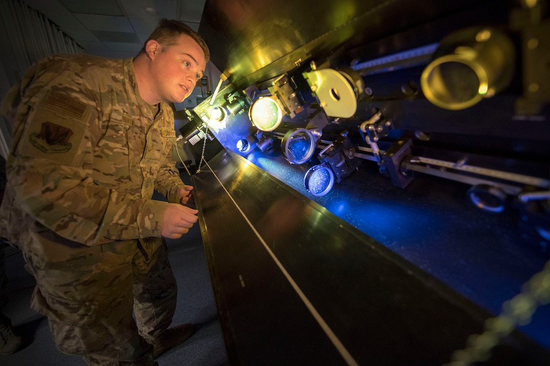 Senior Airman Sidney Johnson, 2d Weather Squadron, Detachment 4, solar analyst, focuses telescope lenses, March 19, 2019, on Holloman Air Force Base, N.M. Analysts are given two minutes to report routine or event solar findings to to geophysical and solar activity forecasters who then push additional findings within six minutes to DoD space weather users, such as Air Force Space Command, Joint Space Operations Center, NORAD, and Joint Force, and in addition, to civilian customers such as NASA and the Federal Aviation Administration. (U.S. Air Force photo by Staff Sgt. Christine Groening)