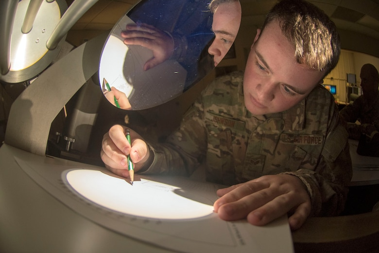 Senior Airman Sidney Johnson, 2d Weather Squadron, Detachment 4, solar analyst, completes a daily sunspot analysis, March 19, 2019, on Holloman Air Force Base, N.M. Holloman is one of five DoD solar observatories around the world. (U.S. Air Force photo by Staff Sgt. Christine Groening)