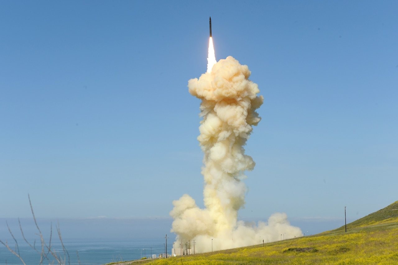 A missile interceptor launches amid an ignition cloud.