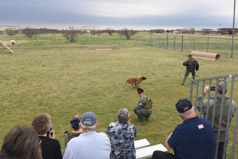 U.S. Air Force 17th Security Forces military working dogs put on demonstrations for guests of the Fritz Military Working Dog Kennel unveiling on Goodfellow Air Force Base, Texas, March 29, 2019. During the demonstration, guests saw the dogs run an obstacle course and witnessed how they assist their handlers with vehicle stops and on foot. (U.S. photo by Airman 1st Class Zachary Chapman/Released)