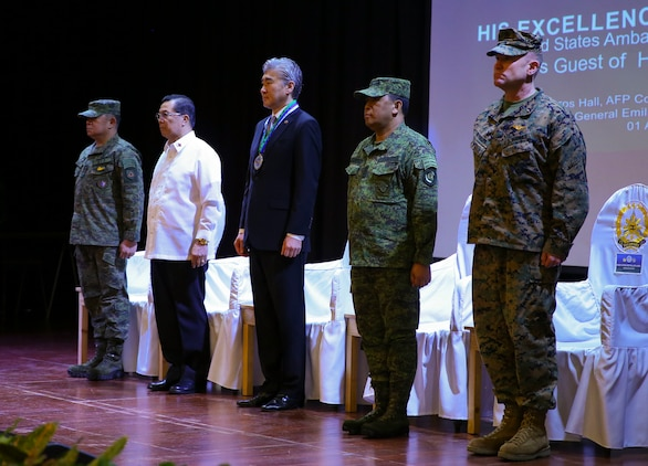 From left, Armed Forces of the Philippines Lt. Gen. Gilbert Gapay, commander, Southern Luzon Command, and Philippine Exercise Co-Director; Undersecretary Cardozo M. Luna, Undersecretary of the Department of National Defense; Sung Y. Kim, U.S. Ambassador to the Philippines; Armed Forces of the Philippines Gen. Benjamin Madrigal, Jr., AFP Chief of Staff; and U.S. Marine Brig. Gen. Christopher A. McPhillips, commanding general, 3rd Marine Expeditionary Brigade stand shoulder-to-shoulder at Tejeros Hall, Camp General Emilio Aguinaldo, Quezon City, Manila, Philippines, April 1, 2019. The ceremony represented the official commencement of Balikatan 2019 and the continued partnership between the United States and the Republic of the Philippines. Balikatan 19, in its 35th iteration, is an annual U.S.-Philippine military training focused on a variety of missions, including humanitarian assistance and disaster relief, counterterrorism, and other combined military operations held from April 1 to April 12.