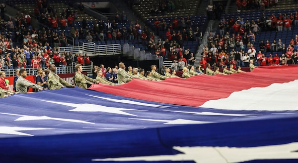 To honor military members past and present, service members from across Joint Base San Antonio, as well as ROTC cadets from the University of Texas at San Antonio, presented the American flag during the National Anthem at the San Antonio Commanders football game at the Alamodome in downtown San Antonio March 31. More than 100 Service members and cadets participated in the flag-holding ceremony to open Sunday's game.