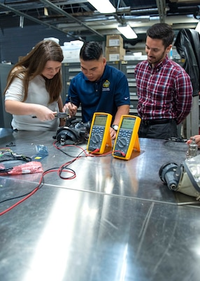 PANAMA CITY, Florida - The LED Air Warning System team from Naval Surface Warfare Center Panama City Division, in collaboration with local academia and an industry partner, has been selected by the Federal Laboratory Consortium to receive one of its highest honors – a 2019 Excellence in Technology Transfer Award.Pictured from left to right: Allie Williams, Tien Le, and Hayden DeForge. U.S. Navy photo by Eddie Green
