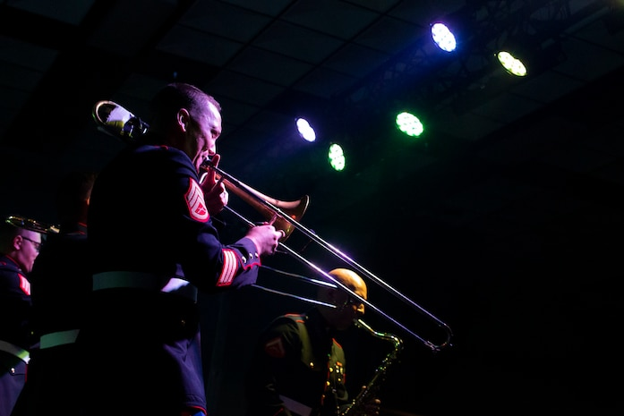 U.S. Marines with the Marine Corps Forces, Pacific band perform on stage at Marine Corps Base Hawaii, Mar. 26, 2019. The performance served as a dress rehearsal for the Marine Corps Forces, Pacific brass and rock band as well as entertain family, friends, and guests. (U.S. Marine Corps photo by Sgt. Alex Kouns)