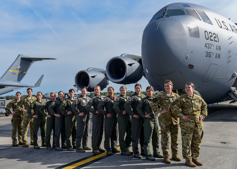 Several all-female air crews take a moment to pose as a team on the flightline March 31, 2019, at Joint Base Charleston, S.C., before departing for an incentive flight celebrating the end of Women's History Month.