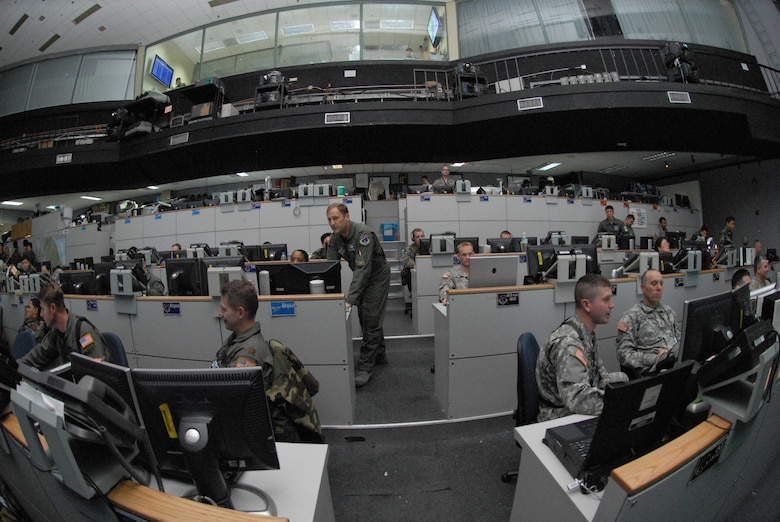"""Col. Rob Kyrouac, (center), 607th Air and Space Operations Center chief of combat operations division, leads members on the """"pit floor"""" of the Korean Air Operations Center during Exercise Key Resolve. Osan Air Base, Republic of Korea, 5 Mar 2008."""