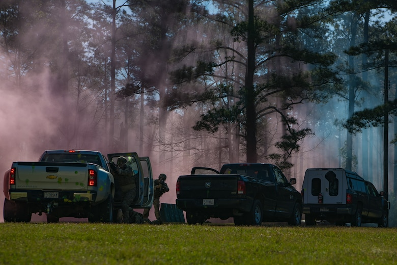 628th Civil Engineer Squadron, Explosive Ordnance Disposal Airmen use their convoy of vehicles as cover while returning fire during combat tactics training March 22, 2019, at Joint Base Charleston, S.C. - Naval Weapons Station.