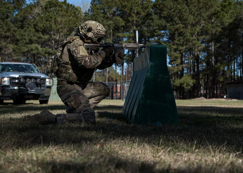 1st Lt. Paul Underwood, 628th Civil Engineer Squadron, Explosive Ordnance Disposal flight chief, returns fire from behind a barrier March 22, 2019, at Joint Base Charleston, S.C. - Naval Weapons Station.