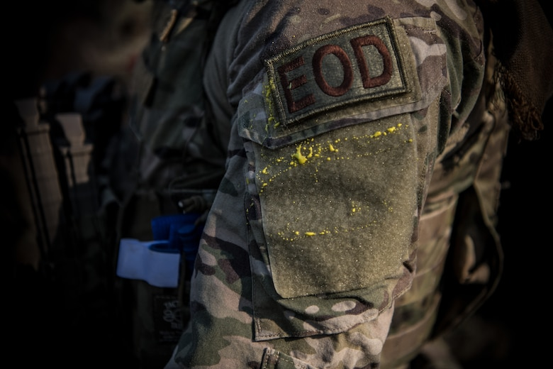 The shoulder of a 628th Civil Engineer Squadron, Explosive Ordnance Disposal flight, Airman covered in paint after a routine training exercise, March 22, 2019, at a training compound on the Joint Base Charleston, S.C. - Naval Weapons Station.