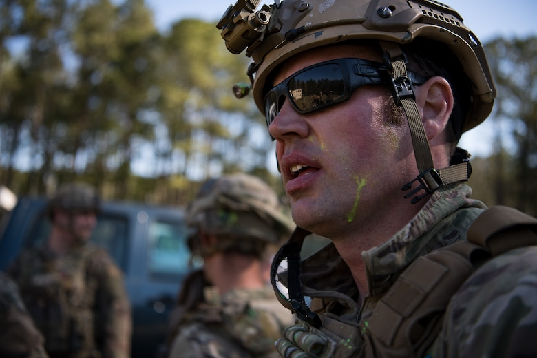 A 628th Explosive Ordnance Disposal Airman speaks to his team members after the conclusion of combat tactics training March 22, 2019, at Joint Base Charleston, S.C.