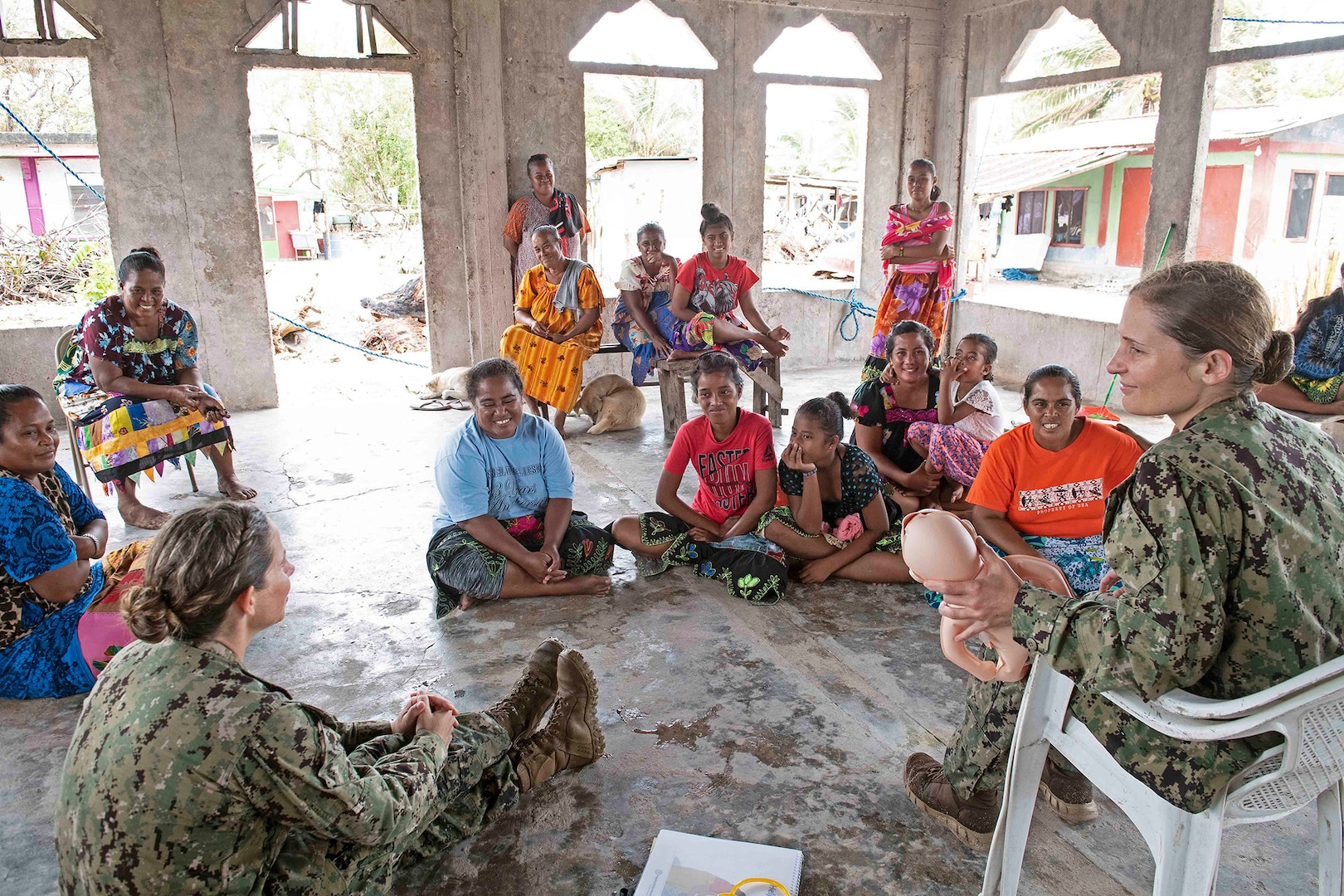Lieutenant Commander Erika Schilling, left, and Lieutenant (junior grade) Natalie Spritzer teach Helping Babies Breathe class to local Chuukese women and girls during largest annual multinational humanitarian assistance and disaster relief preparedness mission conducted in Indo-Pacific, Pacific