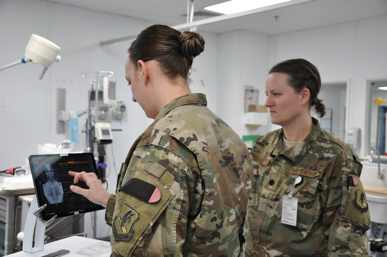 Emergency room nurse Capt. Katie Barnack and trauma surgeon Lt. Col. (Dr.) Valerie Sams, currently deployed to the 455th Expeditionary Medical Group at Bagram Airfield, Afghanistan, demonstrate the T6 Health System, which is in trial phase at the Craig Joint Theater Hospital.
