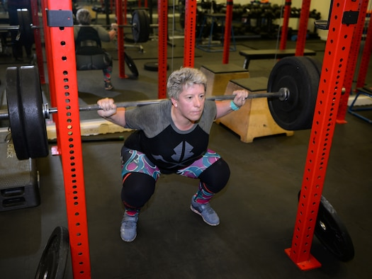 Sarah Marsden, 100th Civil Engineer Squadron environmental engineer, performs a squat during a workout session on RAF Mildenhall, England, March 26, 2019. Marsden is a champion powerlifter, and has earned medals from British, European and World Championships. (U.S. Air Force photo by Karen Abeyasekere)
