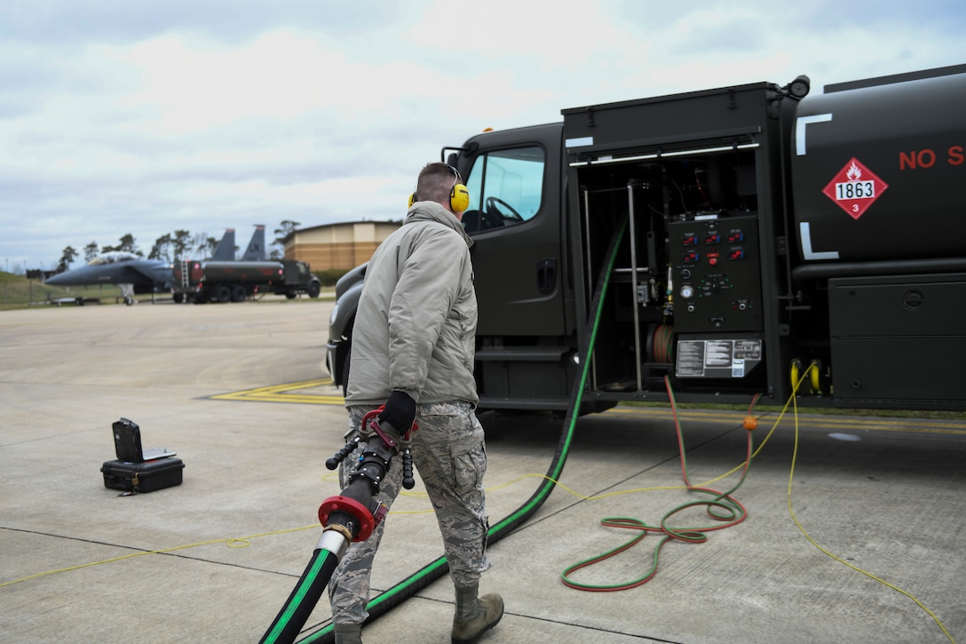 A 48th Logistics Readiness Squadron Fuels Distribution operator returns a fuel hose to an Isometric R-11 Refueling Truck at Royal Air Force Lakenheath, England, March 12, 2019. The vehicles improve the capabilities of the 48th LRS with advanced safety features and up-to-date hardware. (U.S. Air Force photo by Senior Airman Malcolm Mayfield)
