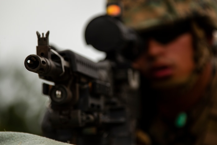 Lance Cpl. Samuel Flores, a heavy equipment operator with Combat Logistics Battalion 31, mans a firing position during machine gun training at Camp Hansen, Okinawa, Japan, March 29, 2019. Flores, a native of Miami, graduated from Miami Coral Park High School in September 2016 before enlisting in January the following year. CLB-31 is the Logistics Combat Element for the 31st Marine Expeditionary Unit. The 31st MEU, the Marine Corps' only continuously forward-deployed MEU partnering with the U.S. Navy's Amphibious Squadron 11, provides a flexible and lethal force ready to perform a wide range of military operations as the premier crisis response force in the Indo-Pacific region.