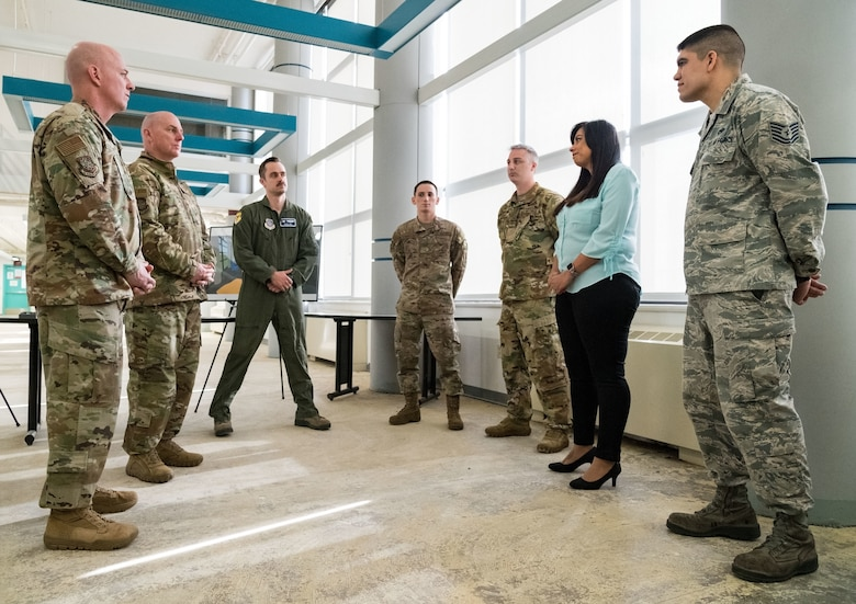 On the left, Chief Master Sgt. Chris Simpson, command chief, and Maj. Gen. Sam Barrett, commander, both from 18th Air Force, listen to Lorraine Kmiec, 436th Force Support Squadron management analyst, on the process and status of the wing's Innovation Lab March 20, 2019, at Dover Air Force Base, Del. Kmiec and current members of the wing's innovation team briefed Barrett and Simpson about completed, current and future innovation team projects. (U.S. Air Force photo by Roland Balik)