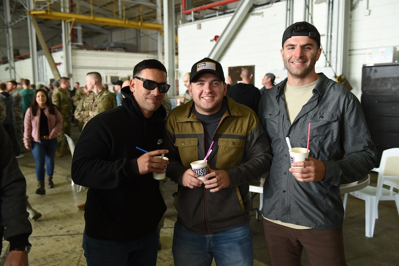 Airmen have their photo taken after receiving root beer floats March 29, 2019, at Incirlik Air Base, Turkey.