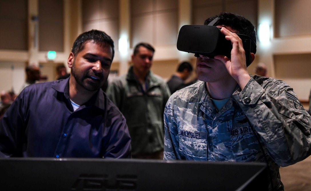 Senior Airman Taylor San Miguel, 11th Space Warning Squadron satellite systems operator tries out a virtual reality space tool Feb. 14, 2018 on Buckley Air Force Base, CO. Space operators were encouraged to test the prototype space tools and give feedback on what should be improved in order to create a product operators could use effectively. (U.S. Air Force photo by Airman 1st Class Michael D. Mathews)