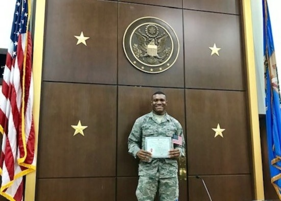 Airman 1st Class Godspower Igben, 507th Force Support Squadron food operations specialist, stands for a photograph with his U.S. citizenship certificate in an Oklahoma City courthouse Feb. 22, 2019.  Igben was raised in Lagos, Nigeria, and moved to the U.S. when he was 22 years old. Igben's family members served in the Nigerian military, inspiring him to join the U.S. Air Force Reserve. Wingmen within his unit attended the citizenship ceremony in a show of support as Igben became a U.S. citizen. (U.S. Air Force photo by Master Sgt. Melissa Childers)