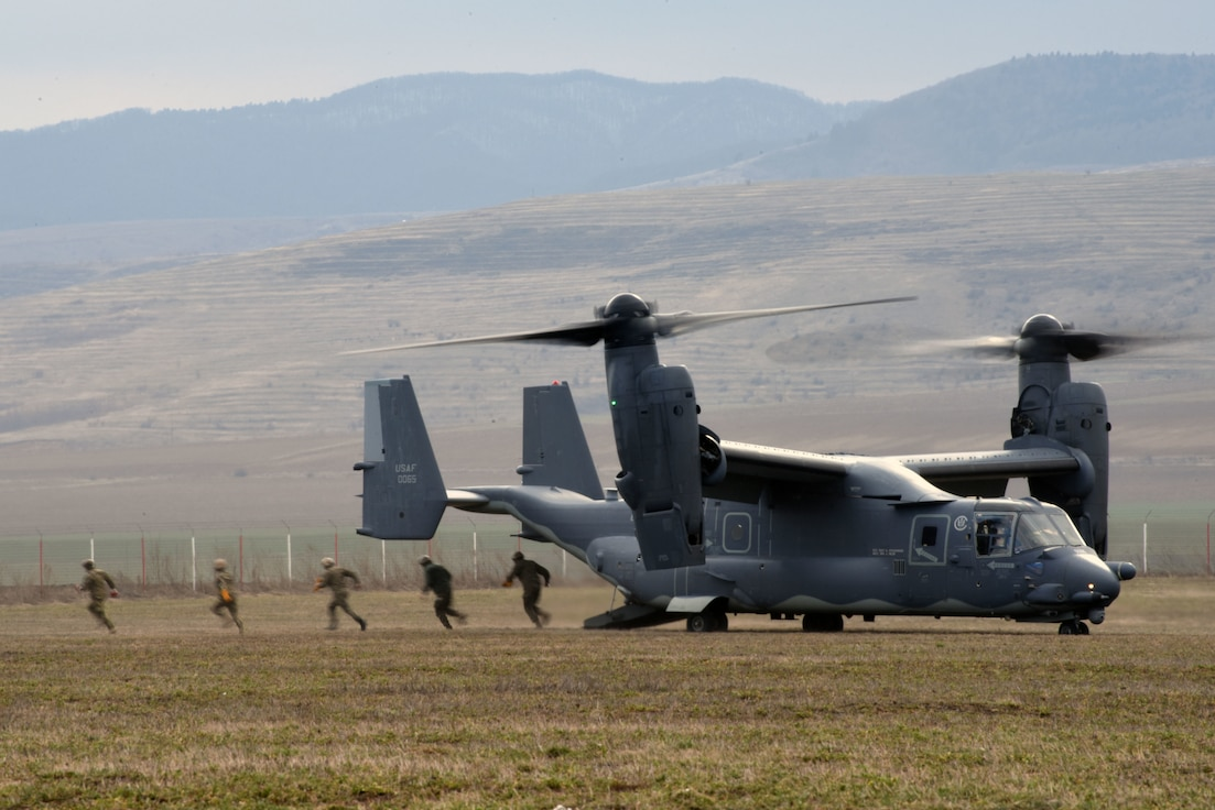 Romanian Special Operation Forces exit a CV-22 Osprey assigned to a 352nd Special Operations Wing, during a combined training March 12, 2019, near Bacau, Romania. Side-by-side, US Air Force's 7th Special Operation Squadron, assigned to the 352nd SOW and ROU SOF conducted day and night fast rope infiltration and exfiltration operations (FRIES) and low-level flying. Through these pieces of training, SOF members demonstrate and strengthen partner nation relationships and air operations in the European Theatre. (U.S. Army photo by Staff Sgt. Elizabeth Pena)