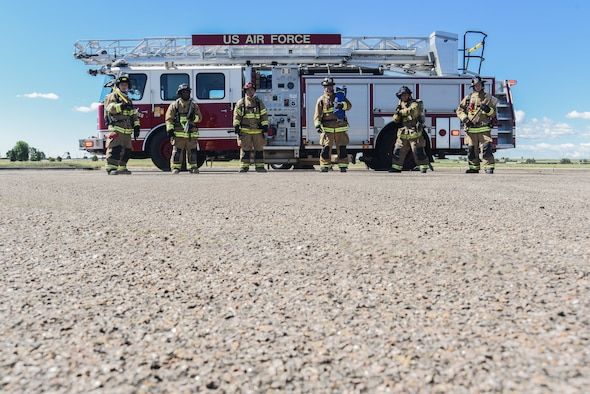 Airmen from the F.E. Warren Fire and Emergency Services gear up for training with fire resistant clothing, oxygen tanks and fire axes, June 18, 2018 at F.E. Warren Air Force Base, Wyo. In 2010 the F.E. Warren fire department began the Commission on Fire Accreditation International accreditation process and first achieved it in 2014. (U.S. Air Force photo by Airman 1st Class Abbigayle Williams)