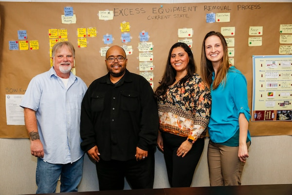 FROM LEFT TO RIGHT: Norfolk Naval Shipyard's Kelly Carson, Code 100PI Engineering Technician; Khiari Tyler, Code 100PI Master Black Belt Instructor and NAVSEA Lean Six Sigma College Branch Head; Clara Cuervo, Code 100PI Industrial Engineer; Megan Hanni, Code 100PI Engineering Technician.