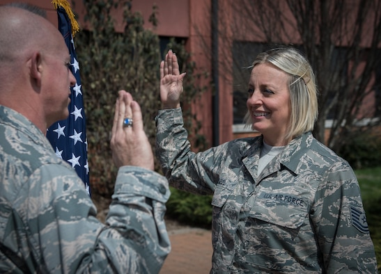 """Tech. Sgt. Nikki Seibel, Air Force Reserve Recruiting, recites the Oath of Enlistment given by Lt. Col. Stan Paregien, 932nd Airlift Wing Public Affairs officer, April 1, 2019, Scott Air Force Base, Illinois.  Seibel will begin her next chapter in her Air Force story with a move to Boston to continue her role as an Air Force Reserve recruiter. """"I've enlisted over 150 Citizen Airmen in the last four years and can't wait to change more lives,"""" said Seibel. (U.S. Air Force photo by Christopher Parr)"""