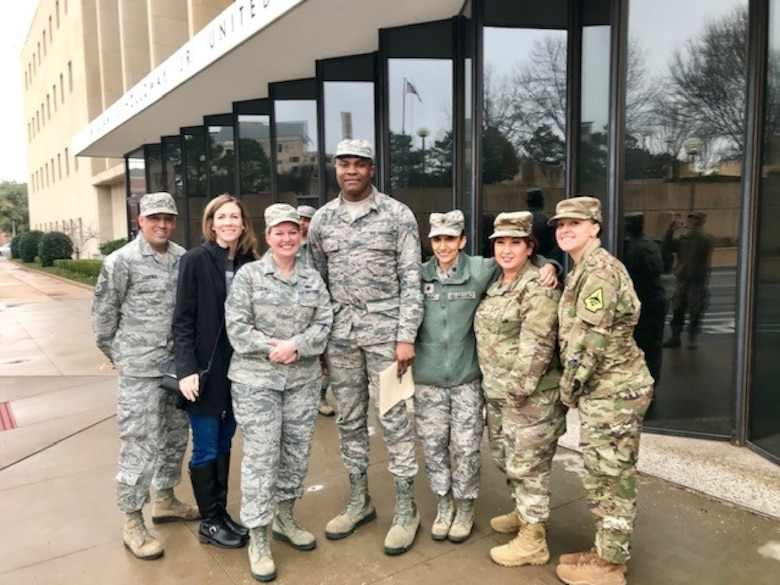 Airman 1st Class Godspower Igben, 507th Force Support Squadron food operations specialist, stands for a photograph with members of his unit after attaining U.S. citizenship in an Oklahoma City courthouse Feb. 22, 2019. Igben was raised in Lagos, Nigeria, and moved to the U.S. when he was 22 years old. Igben's family members served in the Nigerian military, inspiring him to join the U.S. Air Force Reserve. Wingmen within his unit attended the citizenship ceremony in a show of support as Igben became a U.S. citizen. (U.S. Air Force photo by Master Sgt. Melissa Childers)