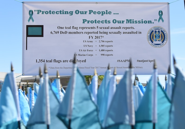 A Sexual Assault Awareness Month banner is displayed near the Keesler Base Exchange satellite pharmacy on Keesler Air Force Base, Mississippi, April 2, 2019. Each flag represents five Department of Defense members who reported being sexually assaulted in fiscal year 2017. The 1,354 flag display will be moved to several locations around the base throughout the month. Keesler's Sexual Assault Prevention and Response office provides sexual assault response coordinators and victim advocates to assist victims and survivors of sexual assault. (U.S. Air Force photo by Kemberly Groue)