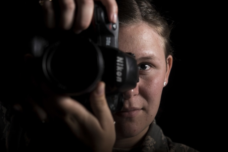 Airman 1st Class Aubree Milks, 30th Space Wing Public Affairs photojournalist, prepares to take a photo April 2, 2019, at Vandenberg Air Force Base, Calif. Milks documents Vandenberg AFB's rocket launches and other missions across base. (U.S. Air Force photo by Airman 1st Class Hanah Abercrombie)