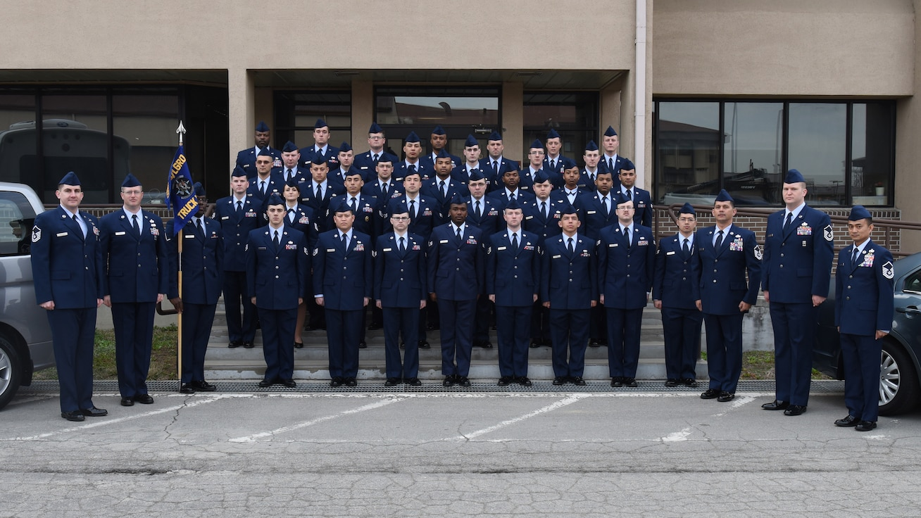 U.S. Air Force grounds transportation Airmen assigned to the 51st Logistics Readiness Squadron pose for a photo at Osan Air Base, Republic of Korea, March 29, 2019. The ground transportation flight conducted their annual service dress inspection in correlations with their protocol program, where they provide transportation services to distinguished visitors. (U.S. Air Force photo by Staff Sgt. Sergio A. Gamboa)