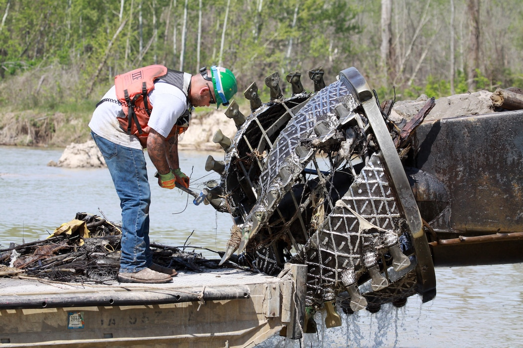 """A U.S. Army Engineer, Galveston District contractor clears trapped debris from a cutter head from the Dredge """"LP"""" during operations  near Kingwood, Texas upstream of West Lake Houston Parkway.   Since Sept. 20, 2018, approximately 1.4 million cubic yards of Hurricane Harvey silt and debris was pumped to two placement areas. The FEMA funded emergency flood action is scheduled for completion in early May 2019."""