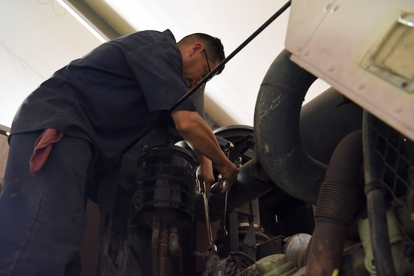 Staff Sgt. Gabriel Villalpando, 380th Expeditionary Logistics Readiness Squadron firetruck and refueling maintenance craftsman, removes the alternator belt from a fire truck at Al Dhafra Air Base, United Arab Emirates, Mar. 28, 2019.