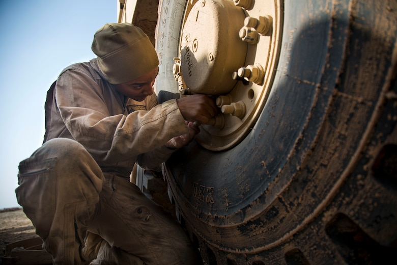 U.S. Marine Corp Sgt. Naomi L. Polumbo, a motor transport mechanic with Combat Logistics Detachment 34, attached to Special Purpose Marine Air Ground Task Force Crisis Response-Central Command, checks a seal for leakage on a mine-resistant, ambush-protected vehicle in Southwest Asia Jan. 26, 2019. As a quick reaction force, the SPMAGTF-CR-CC is capable of deploying aviation, ground and logistical forces forward at a moment's notice.