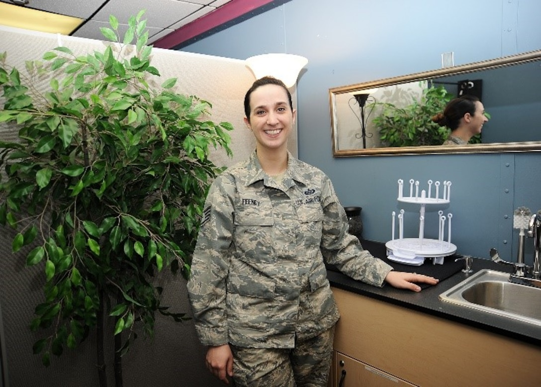 Staff Sgt. Trisha Feeney, 20th Intelligence Squadron, poses for photo March 12, 2019 in the squadron's new lactation room on Offutt Air Force Base, Nebraska. Feeney established and designed the room to give lactating mom's privacy as they pump breastmilk for their babies. (U.S. Air Force courtesy photo)