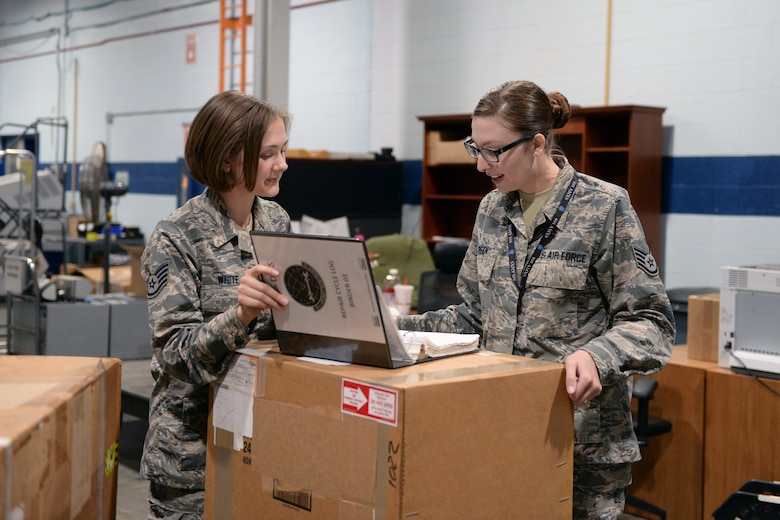Staff Sgt. Destine White, 55th Logistics Readiness Squadron NCO in charge of equipment accounts, assists Staff Sgt. Falena Green, 595th Aircraft Maintenance Squadron, with returning an aircraft part in the Bennie L. Davis Maintenance Facility Warehouse Monday, Oct. 16, 2017, on Offutt Air Force Base, Nebraska. Green is a regular customer of the warehouse bringing aircraft parts for repair and picking up new parts to take back to her unit. (U.S. Air Force photo by Tech. Sgt. Rachelle Blake)