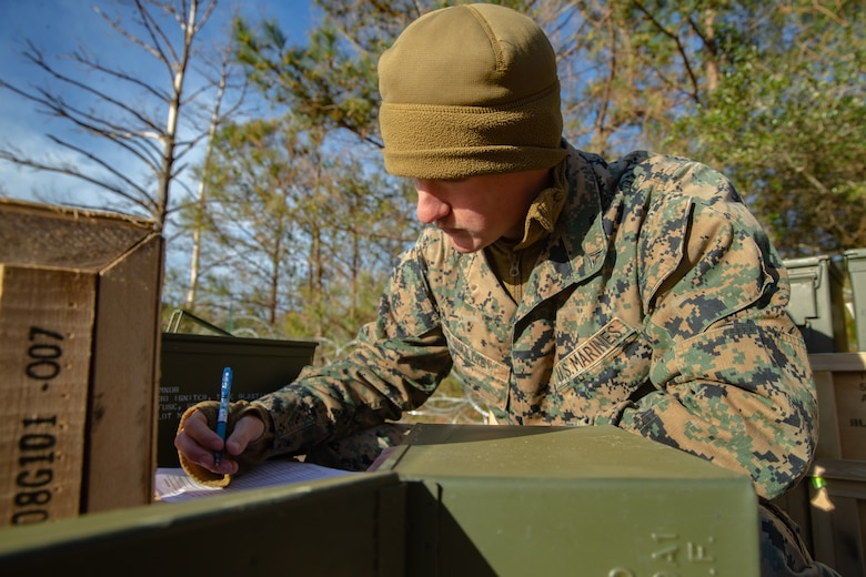 U.S. Marine Lance Cpl. Landon Wallis with Ammunition Company, 2nd Supply Battalion, Combat Logistics Group 25, 2nd Marine Logistics Group, counts ammunition on Camp Lejeune, N.C., March 27, 2019. Ammo Co. constructed a Field Ammunition Supply Point in support of 2nd Marine Division to supply everything from 5.56 millimeter small arms to high explosive ordnance. (U.S. Marine Corps photo by Lance Cpl. Damion Hatch Jr.)