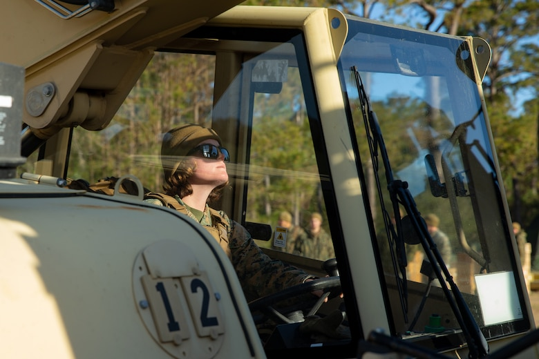 U.S. Marine Lance Cpl. Kaytlin Deschanes with Ammunition Company, 2nd Supply Battalion, Combat Logistics Group 25, 2nd Marine Logistics Group operates a light capability rough terrain forklift to load ammunition onto a medium tactical vehicle replacement on Camp Lejeune, N.C., March 27. 2019. Ammo Co. constructed a Field Ammunition Supply Point in support of 2nd Marine Division to supply everything from 5.56 millimeter small arms to high explosive ordnance. (U.S. Marine Corps photo by Lance Cpl. Damion Hatch Jr.)