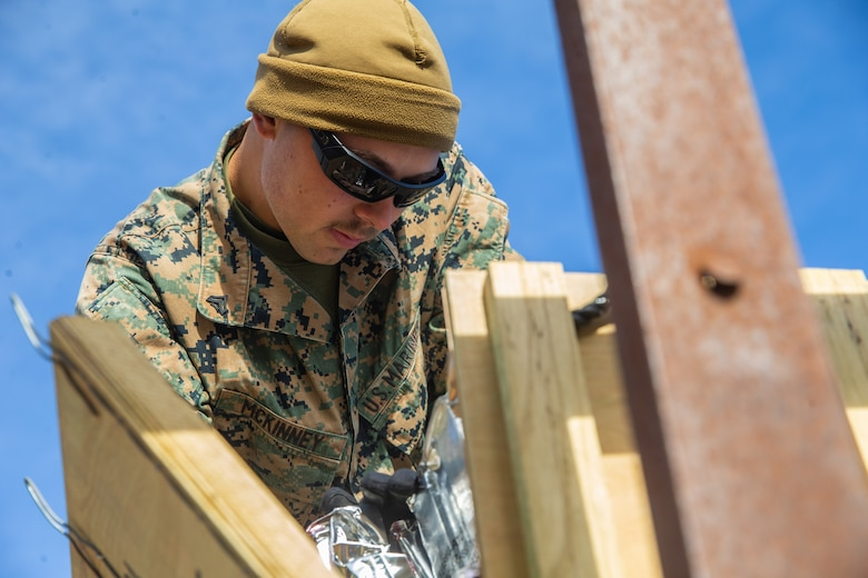 U.S. Marine Cpl. Noah Mckinney with Ammunition Company, 2nd Supply Battalion, Combat Logistics Group 25, 2nd Marine Logistics Group counts left over ammunition on Camp Lejeune, N.C., March 27. 2019. Ammo Co. constructed a Field Ammunition Supply Point in support of 2nd Marine Division to supply everything from 5.56 millimeter small arms to high explosive ordnance. (U.S. Marine Corps photo by Lance Cpl. Damion Hatch Jr.)