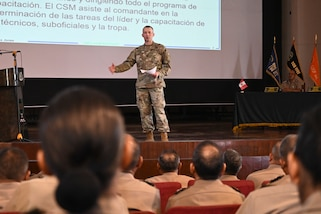 West Virginia Army National Guard state command sergeant major, Command Sgt. Maj. Dusty Jones, discusses the role of the command sergeant major in the United States Army for members of the Peruvian senior enlisted corps March 25, 2019, in Lima, Peru.