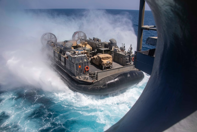 U.S. 5TH FLEET AREA OF OPERATIONS (March 29, 2019) A landing craft, air cushion approaches the Wasp-class amphibious assault ship USS Kearsarge (LHD 3). Kearsarge is the flagship for the Kearsarge Amphibious Ready Group and with the embarked the 22nd Marine Expeditionary Unit is deployed to the U.S. 5th Fleet area of operations in support of naval operations to ensure maritime stability and security in the Central Region, connecting the Mediterranean and the Pacific through the western Indian Ocean and three strategic choke points. (U.S. Navy photo by Mass Communication Specialist 3rd Class Kaitlyn E. Eads/Released)