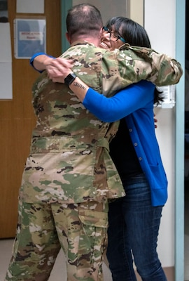 Rita Ibanez hugs Air Force Maj. (Dr.) Matthew Read, acting Extracorporeal Membrane Oxygenation medical director, at Brooke Army Medical Center, Joint Base San Antonio-Fort Sam Houston, March 22. Ibanez met with Read and other members of the ECMO team to thank them for the care she received in 2015.