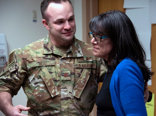 Air Force Maj. (Dr.) Matthew Read, acting Extracorporeal Membrane Oxygenation medical director, shares an emotional moment with former patient, Rita Ibanez, at Brooke Army Medical Center, Joint Base San Antonio-Fort Sam Houston, March 22. Ibanez met with Read and other members of the ECMO team to thank them for the care she received in 2015.