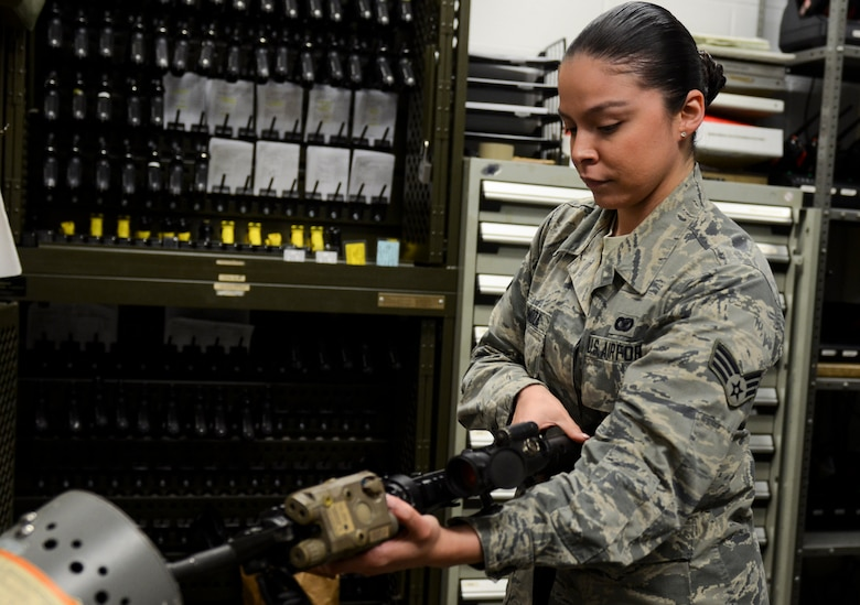 Senior Airman Sofia Espinoza, 628th Security Forces Squadron base armorer, inspect an M-4 rifle during a routine weapon check March 27, 2019, at Joint Base Charleston, S.C. Espinoza was awarded the 2018 Junior Enlisted Woman of the Year award by the Palmetto Chapter of Women In Defense March 21, 2019.