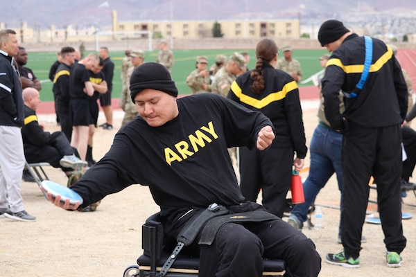 Spc. Kevin Holyan launches a few practice seated discus throws prior to the field event March 11, during the Army Trials at Fort Bliss, Texas. The 2019 Army Trials is an adaptive sports competition with more than 100 wounded, ill and injured active-duty Soldiers and veterans competing in 14 different sports for the opportunity to represent Team Army at the 2019 Department of Defense Warrior Games in Tampa, Florida.