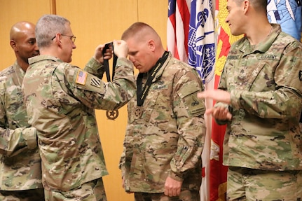 Staff Sgt. Matthew Brown, Brooke Army Medical Center, Warrior Transition Battalion, receives two gold medals during a BAMC awards ceremony March 26. Brown earned his medals participating in the discus and shot put events at the 2019 Army Trials, hosted at Fort Bliss, Texas, March 5-16.